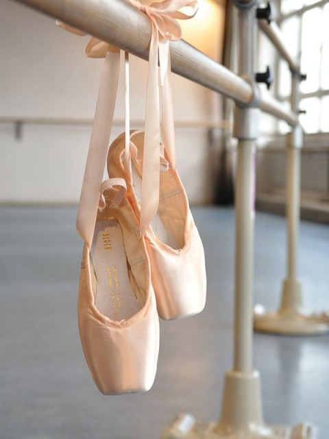 ballet shoes hanging on a rail
